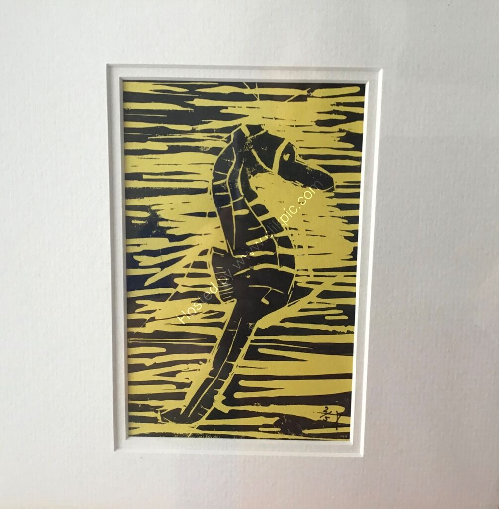 A linocut of a seahorse, printed in black on yellow