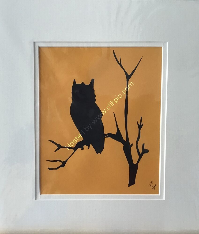 An etched owl printed as a silhouette in black on golden orange paper