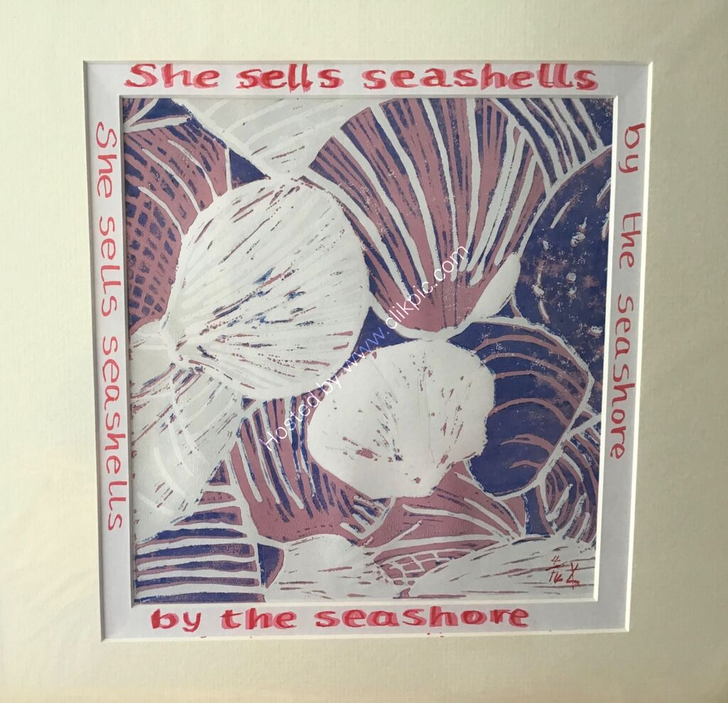 A linocut print showing seashells, pink and navy, words around mount