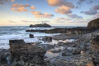 CLOUDS OVER GODREVY LIGHTHOUSE