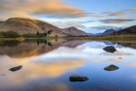CLOUDS REFLECTIONS AT SUNRISE (Kilchurn Castle)