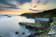 OLD LIZARD LIFEBOAT STATION AT SUNSET