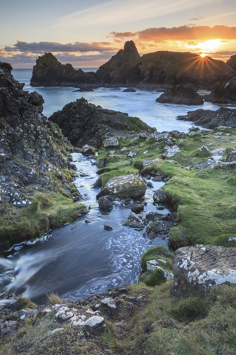 SETTING SUN AT KYNANCE COVE