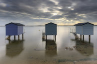 SHAFTS OF LIGHT OVER OSEA BEACH HUTS