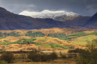 SNOW CAPPED PEAKS OVER LOCH TROMLEE