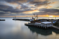 SUNRISE OVER THE DRY DOCK AT NEWLYN