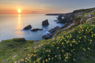 THE SETTING SUN AT THE BEDRUTHAN STEPS