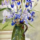 Irises in green vase