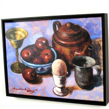 Red plums in a Blue bowl with other objects