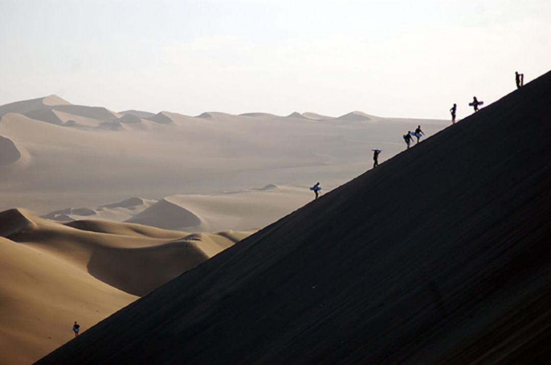 Sandboarders in Huacachina