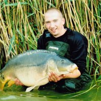 Rob with a low 30lb mirror from Boulencourt, France.