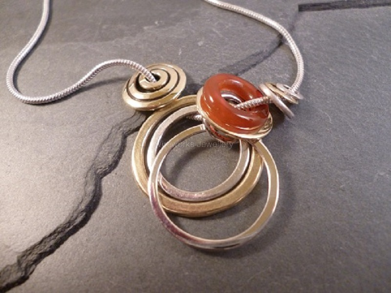Silver and brass with a carnelian ring