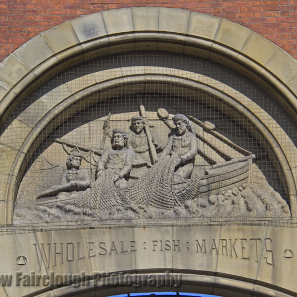 The Story of Fishing captured in the Stone relief on the preserved façade of the former Smithfield Wholesale Fish Market, Northern Quarter, Manchester.