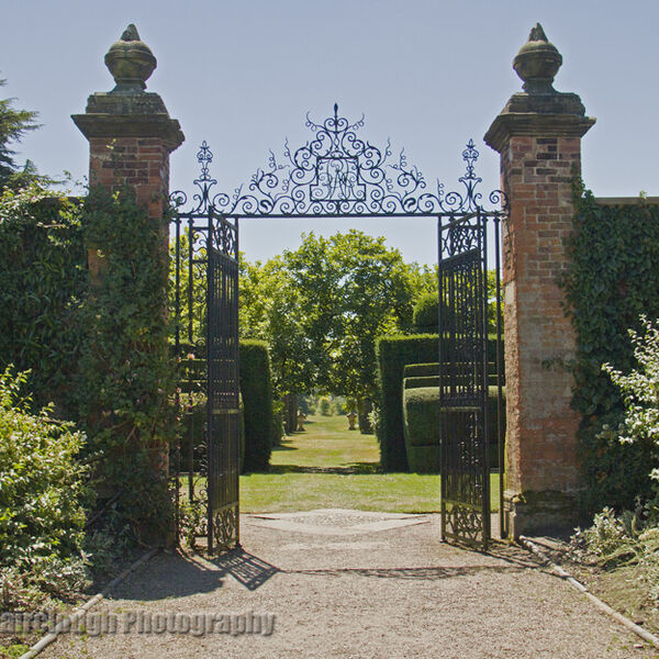 Formal garden with wrought iron gates leading to the Ilex Avenue