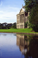 The Facade of Lyme Hall reflected in the lake
