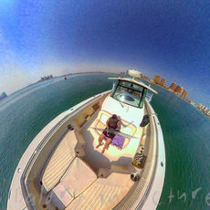 The World is Round, out on the water on a Grady-White in the desert sun!