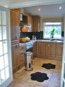 Kitchen from adjoining double doors into dining area