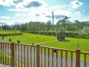 View from decking of Lodge looking over bottom of Park area