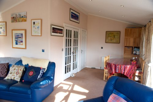 Dining Area Off Living Room Showing Double Kitchen Doors Closed