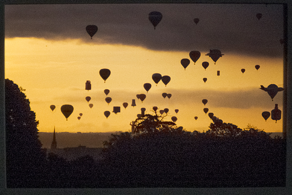 Balloons Sllhouetted against an evening sky. 1992