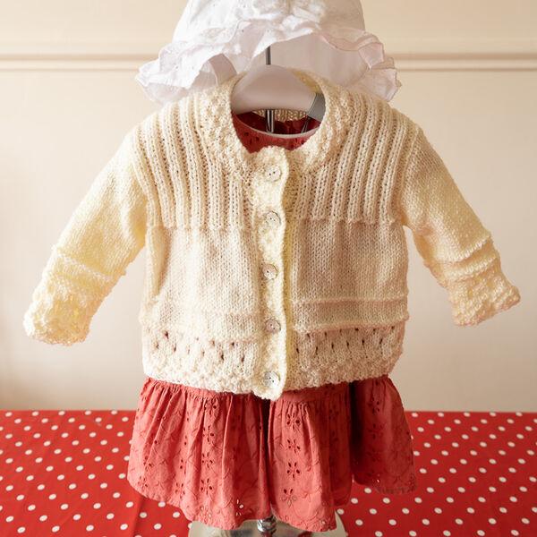 Round Necked Cardigan in Cream Shimmer Yarn.