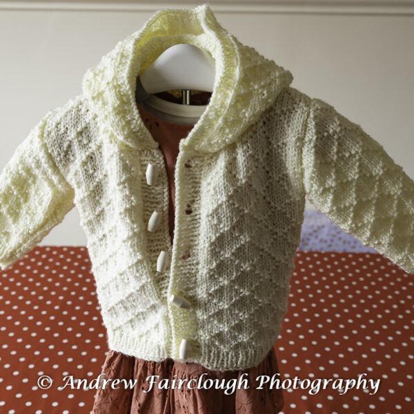 Diamond Design Hooded Jacket in Cream Shimmer yarn.