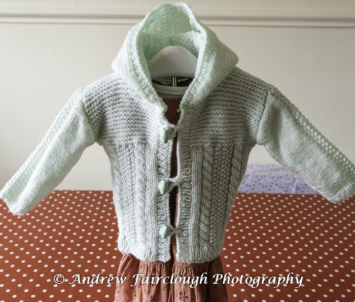 Mint Green Cable and Moss Stitch Hooded Jacket.