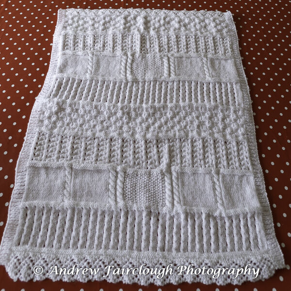 White Shimmer Baby Blanket with two edges ribbed and two edges lace.