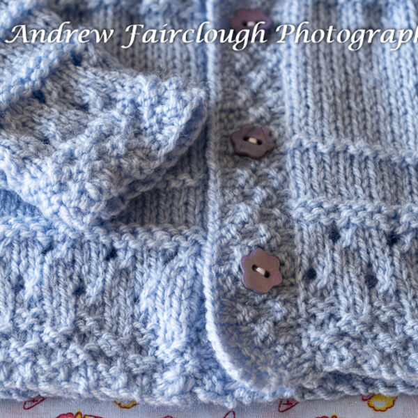 Blue Cardigan button and pattern detail