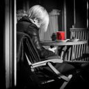 Blonde with red coffee cup