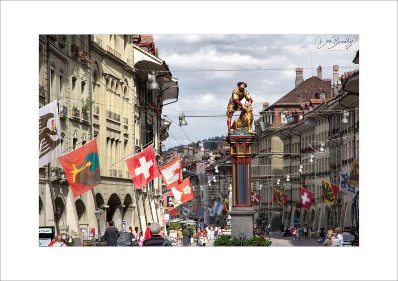 Simsonbrunnen and flags, Kramgasse. Bern, Switzerland