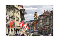 Simsonbrunnen and flags, Kramgasse. Bern, Switzerland. ISO broadley-photo.com