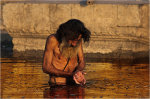 Man bathing in the river Ganges at Varanasi India