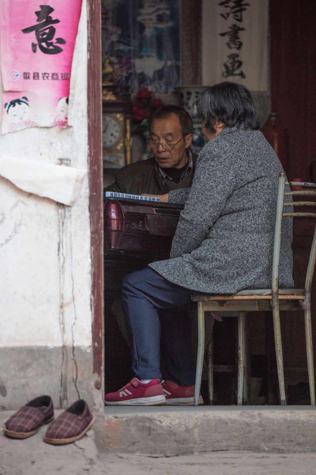 China 011: mountain village two, playing mahjong