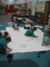 Drawing round our templates.