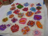Everyone created their own flower design for the felted banner.