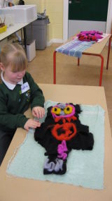 Making a 'wild thing' to put onto the felted banner.