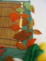 The felted leaves are beautiful and ready to be put in place on the main design background.