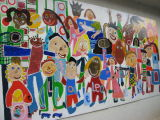 Our mural in place on a wall in the playground.