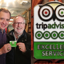 Receiving TripAdvisor pin for Excellent Service