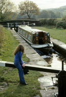 Macclesfield canal lock with narrowboat.
