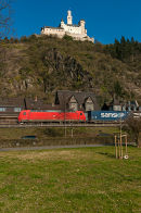 Freight train passing the Marksburg, Braubach.