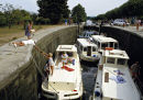 Boats in locks on the Canal du Midi, France. 1980s.
