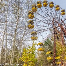 The fairground's ferris wheel still intact awaiting use.