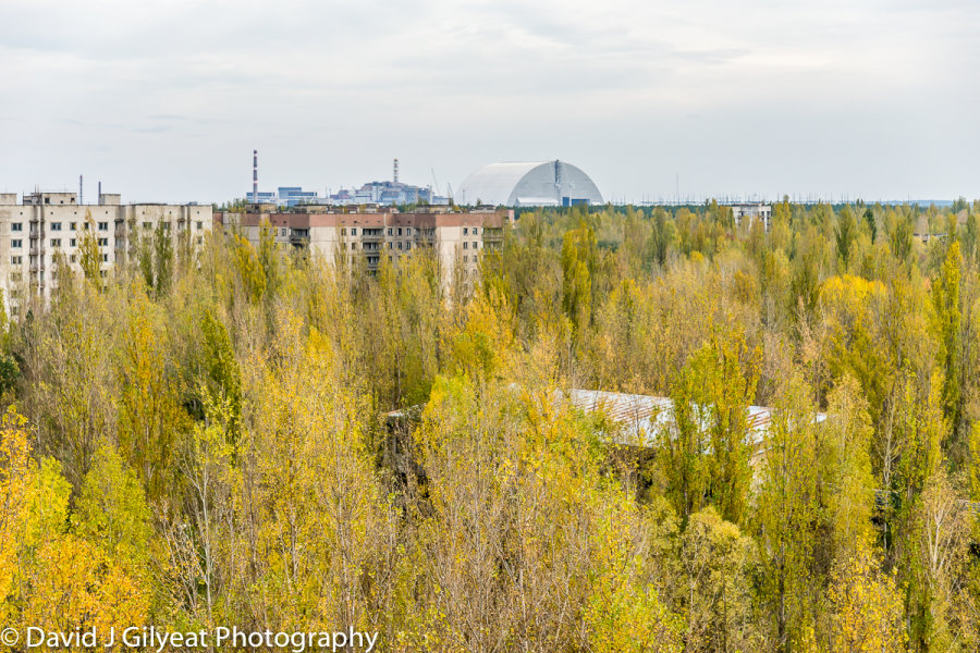 Chernobyl Nuclear Power plant ominously looks over the city of Pripyat.