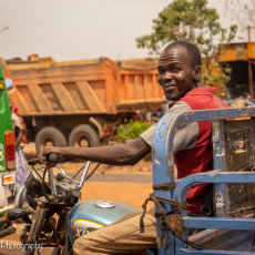 A happy trike rider on his daily task