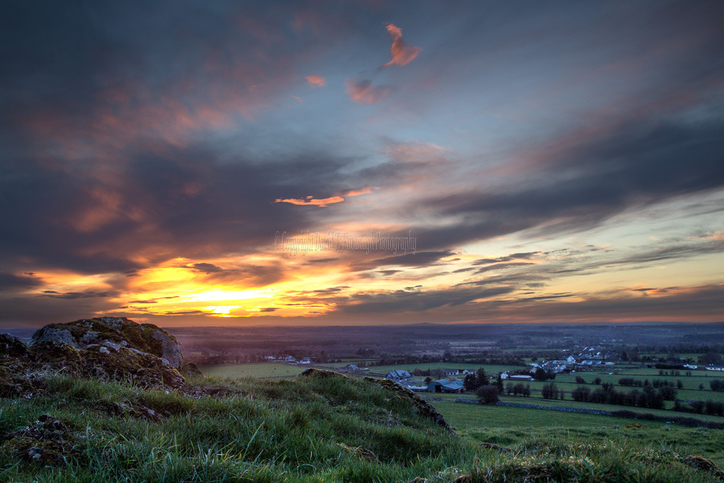 1064-Sun sets on green grass of Croghan Hill Offaly Ireland