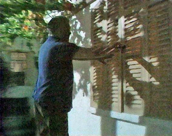 11 A man outside trying the shutters