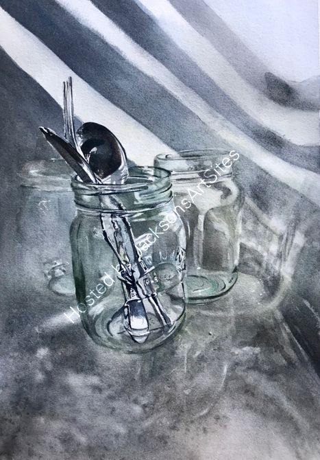 Glass with cutlery in the sink