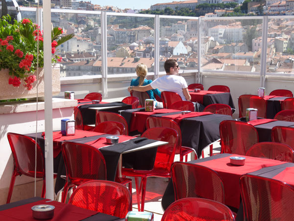 Couple with red tables and chairs